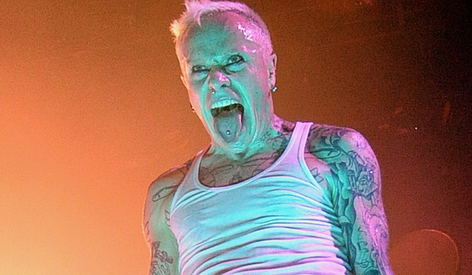 Keith Flint's tearful wife joins hundreds of Prodigy fans for music legend's funeral as mourners rave in the street