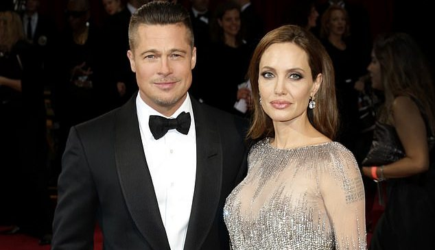Angelina Jolie 'wants Brad Pitt back so they can be a family again and is dragging out their divorce'