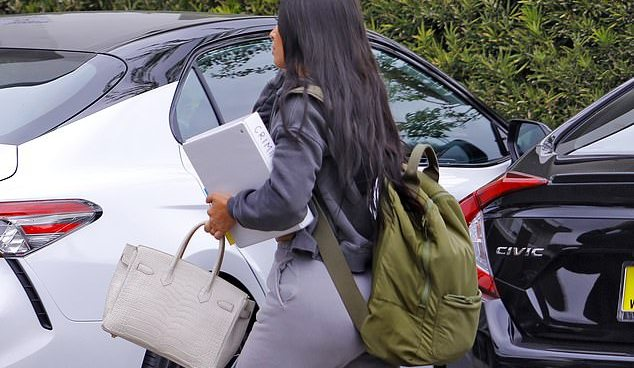 'I aced it': Dressed down Kim Kardashian adopts the student look to sit law school entry exam